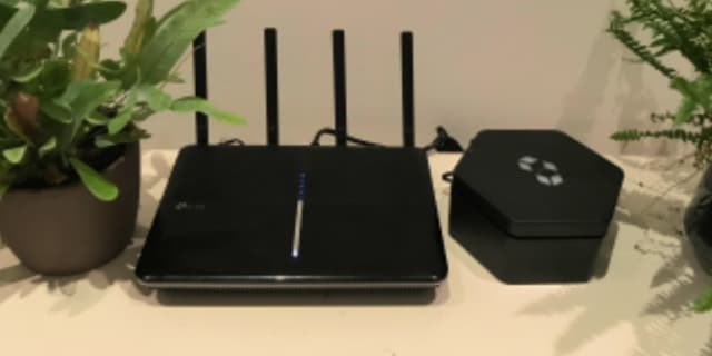 A Cubbit Cell connected to a home router. Image courtesy of Cubbit.