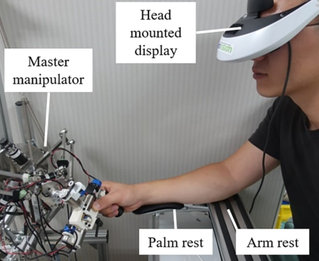 Researchers conducted a pointing experiment using a master console. (Image courtesy of Tokyo Institute of Technology.)