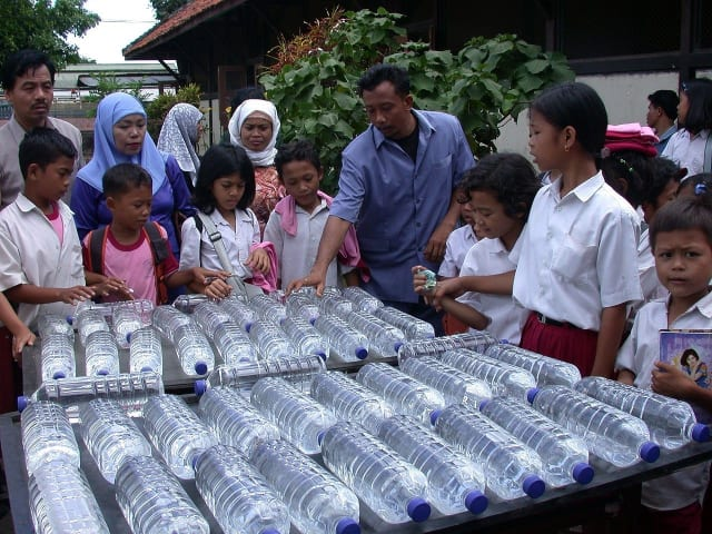Solar disinfection (SODIS) of water in Indonesia using clear PET plastic beverage bottles. (Image courtesy of SODIS Eawag.)