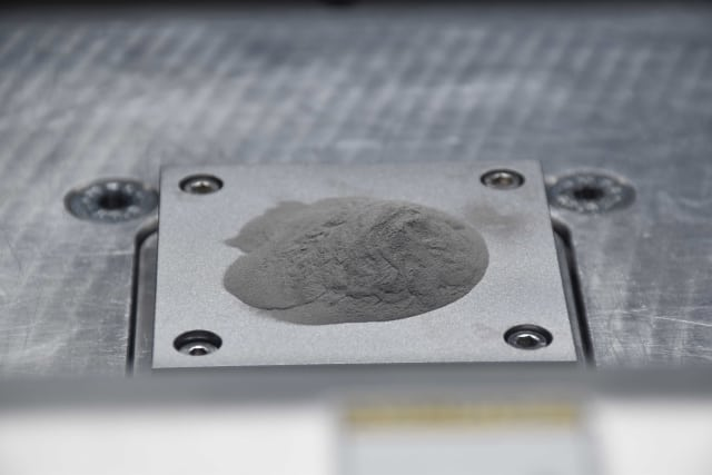 The nanoparticle-functionalized powder is fed into a 3-D printer, which layers the powder and laser-fuses each layer to construct a three-dimensional object. (Image courtesy of HRL Laboratories.)