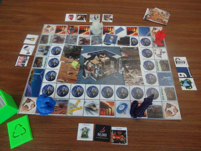 The board game Save the Planet is an open source, cooperative game that is adaptable and customizable, making it an educational tool that grows with kids and enables creative freedom with everything from its