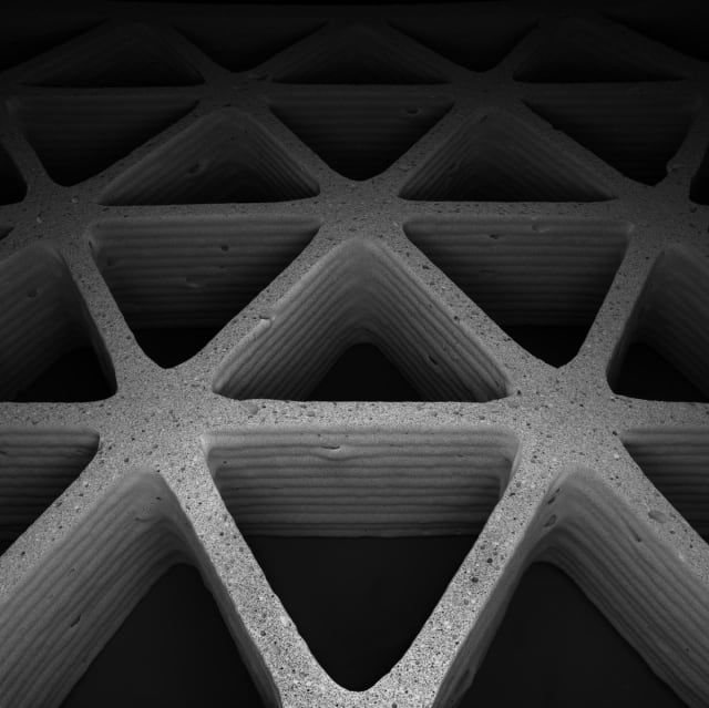 Harvard and MIT researchers 3-D printed lightweight hexagonal and triangular honeycombs (pictured here), with tunable geometry, density, and stiffness using a ceramic foam ink. Their approach could be used to fabricate lightweight structural materials, thermal insulation or tissue scaffolds. (Image courtesy of James Weaver/Wyss Institute.)