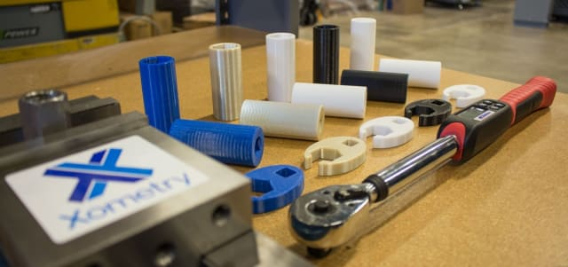 A collection of 3D printed parts. (Image courtesy Xometry.)
