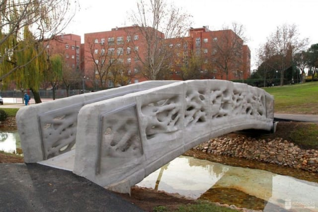 This is the world's first 3D printed bridge, built by ACCIONA with a D-Shape printer from Italian inventor Enrico Dini. It's 1.75 meters wide and 12 meters long. The print material is micro-reinforced concrete. The design was done by the Advanced Architecture of Catalonia (IAAC). (Image courtesy of ACCIONA.)