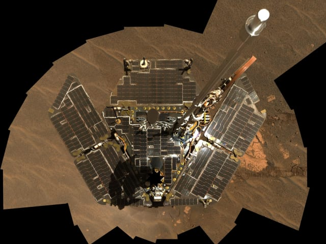 Opportunity used its panoramic camera to take the images combined into this mosaic view of the rover. The downward-looking view omits the mast on which the camera is mounted. It shows Opportunity's solar panels to be relatively dust-free. The images were taken through the camera's 600-, 530- and 480-nanometer filters during Opportunity's 322nd and 323rd Martian days, or sols (Dec. 19 and 20, 2004). (Image courtesy of NASA/JPL-Caltech/Cornell.)