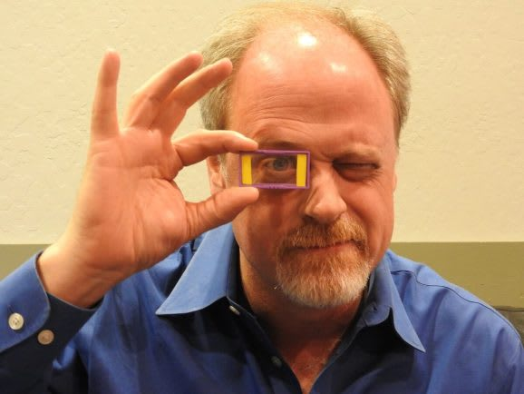 CEO of Akonia in 2016 with the company's HoloMirror display lens, transformed from years of holographic storage research and development. (Image courtesy of Dean Takahashi.)