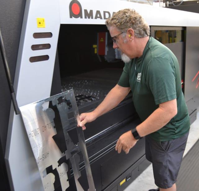 Unloading an AMADA liber laser CNC machine at the Fleet Readiness Center Southeast.