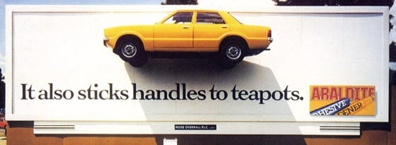 In 1983, the British ad agency FCO Univas showcased the strength of Araldite by gluing a yellow Ford Cortina to a billboard in London. (Image courtesy of Robert Messenger.)