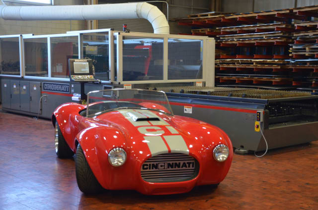 3D-printed Shelby Cobra next to a Big Area Additive Manufacturing system. (Image courtesy of Cincinnati Incorporated.)