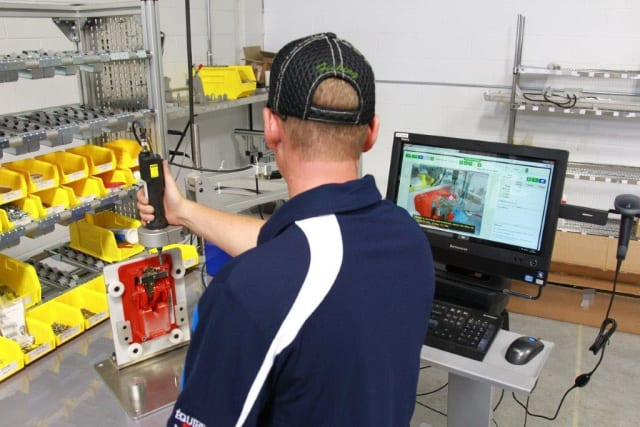Shop floor operator following visual work instructions. As a screw is inserted the torque is recorded in a report in the VKS software and moves the work instruction to the next operation for the operator. (Image courtesy of Visual Knowledge Share.)