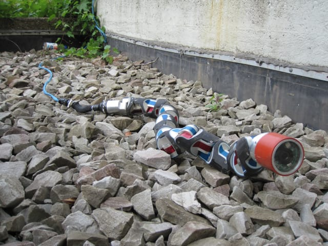 Testing one of CMU's snake robots on rough terrain. (Image courtesy of CMU.)