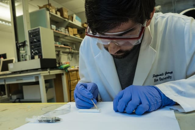 Rice University graduate student Amram Bengio sets up a nanotube fiber antenna for testing. Scientists at Rice and the National Institute of Standards and Technology have determined that nanotube fibers made at Rice can be as good as copper antennas but 20 times lighter. (Image courtesy of Jeff Fitlow/Rice University.)