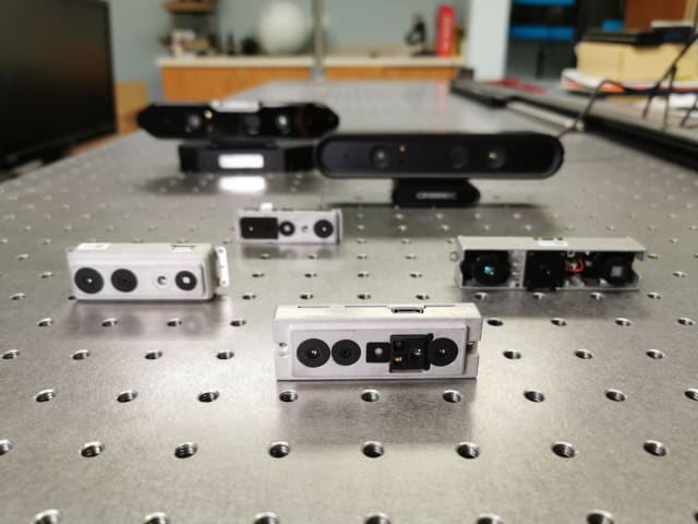 Orbbec's 3D cameras: The Astra Stereo S U3 is in the center front (silver case), while the Astra Mini S is to the back and right (silver case). (Image courtesy of Orbbec.)