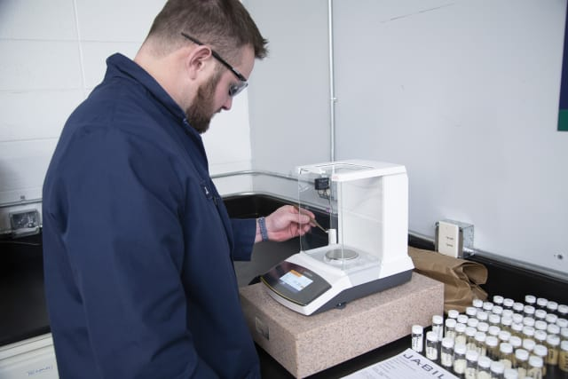 Jabil Additive Manufacturing experts and chemists mix different raw materials during the formulation of Jabil Engineered Materials. (Image courtesy of Jabil.)