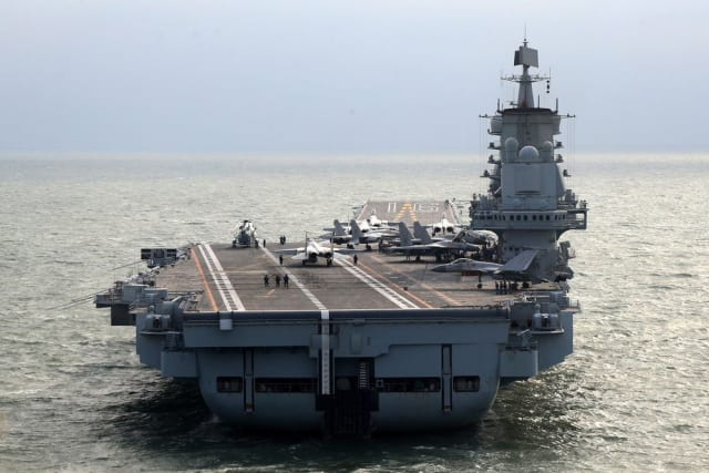 The Laioning at sea with a compliment of aircraft on its deck. (Image courtesy of Xinhua.)