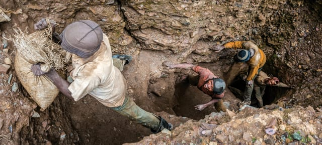 Cobalt miners in the Republic of Congo are often working in unsafe conditions, without proper equipment (Image courtesy of Scholastic.)