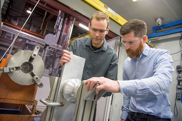Preparing a prototype part for an electric motor in the NRC's cold spray facility. (Image courtesy of NRC.)
