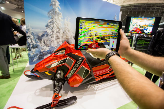 Using augmented reality, PTC shows the snowmobile in a different environment. (Picture courtesy of PTC.)