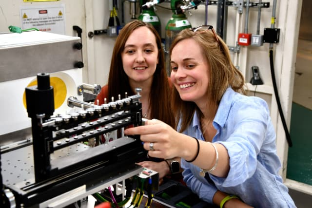 Sarah Day, Senior Support Scientist on I11 with Claire Corkhill, Principal Investigator. (Image courtesy of Diamond Light Source.)