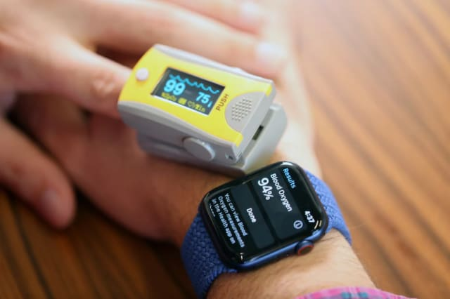 Comparing Apple Watch's readings simultaneously against an FDA-approved pulse oximeter. (Image courtesy of Washington Post.)