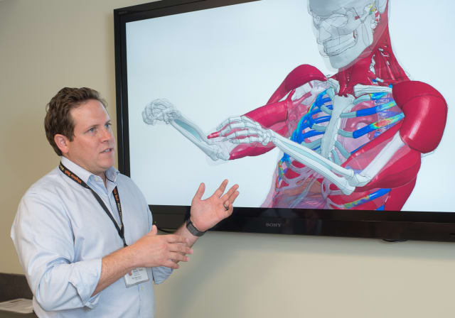 Scott Gayzik, associate professor of biomedical engineering at Wake Forest School of Medicine, explains some of the capabilities of a computational body model. (Image courtesy of Department of Biomedical Engineering, Wake Forest School of Medicine.)