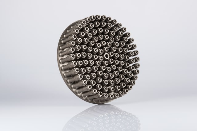 An injector head baseplate.  Redesigning with additive manufacturing reduced the number of components from 248 to 1. (Image courtesy of EOS.)