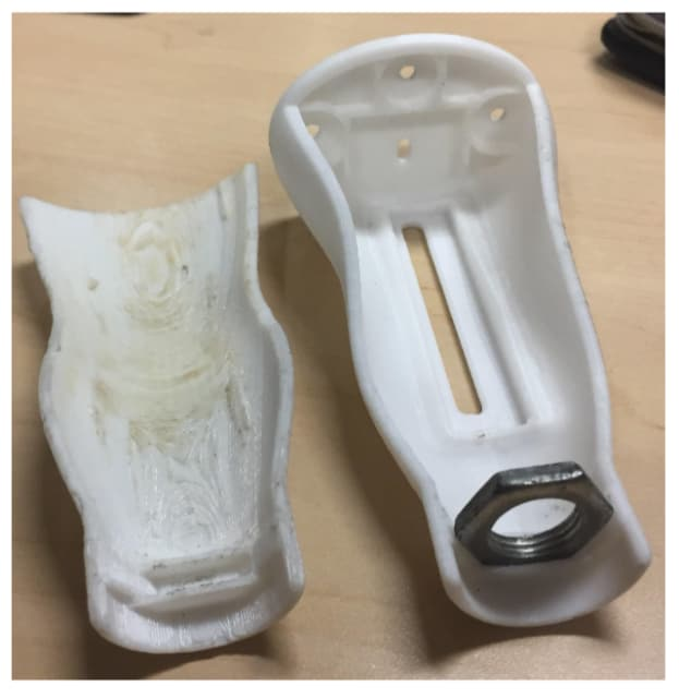 The enclosure for the AIDex hardware, 3D printed in ABS. (Image courtesy of the AIDex team.)