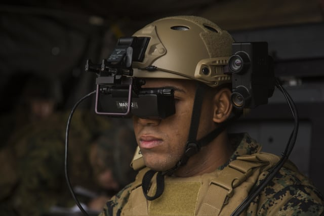 Lance Corporal Jorge Brito uses the Marine's Augmented Immersive Team Trainer to locate virtual enemy tanks at Camp Lejeune, N.C. (Image courtesy of U.S. Marine Corps/Lance Cpl. Juan A. Soto-Delgado.)