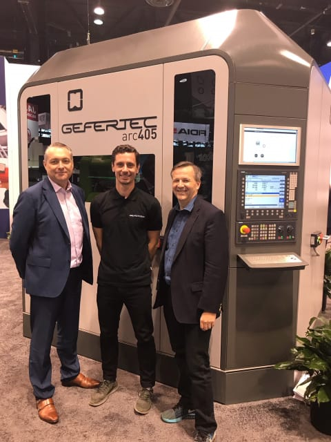 GEFERTEC was one of many companies that sold machines right off the show floor. In this photo, GEFERTEC CEO Tobias Rohrich (center), stands with Harlow CEO Alan Pearce (left) and CFO David Gordon-Smith (right). (Image courtesy of GEFERTEC.)