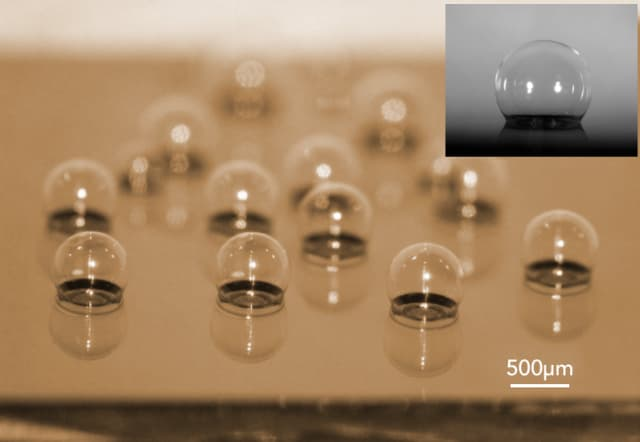 This is a chip-scale glass microspherical shell sensor array blown on a silicon substrate. Insert is a near-perfect spherical shell. (Image courtesy of Tadigadapa Lab/Penn State.)