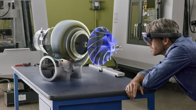 The next generation of HoloLens tech will likely include a more powerful processor (perhaps the Qualcomm Snapdragon 850) and perhaps an improved field-of-view and maybe new controllers or haptics. The price will surely be in the USD 3000-5000 range, which is the cost of the current HoloLens Developer Edition and Enterprise Edition. (Image courtesy of Microsoft.)