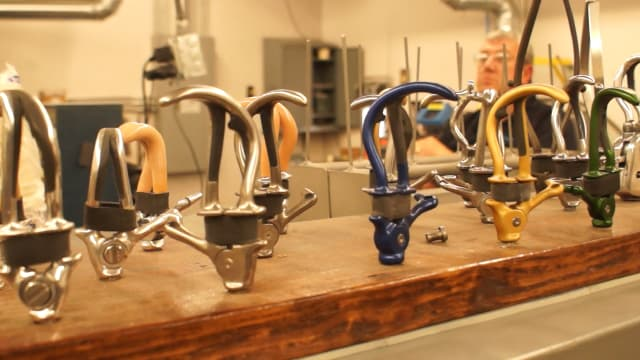 Prosthetics in The Hook Room at Fillauer, which manufactures the majority of prosthetic hooks on the market today. (Image courtesy of the author.)
