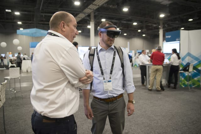 Another HxGN LIVE 2017 attendee tries out the HoloLens. (Image courtesy of Hexagon.)