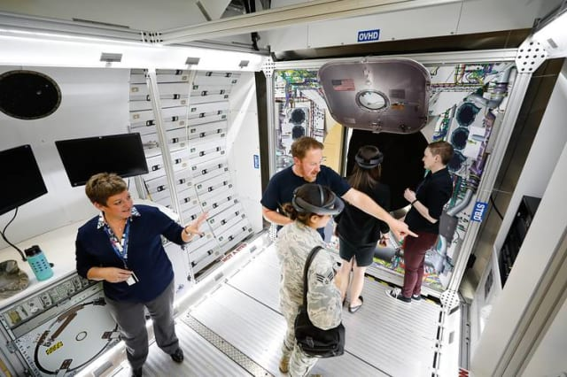 Shelley Peterson (left) shows off Lockheed Martin's use of AR. (Image courtesy of Lockheed Martin.)