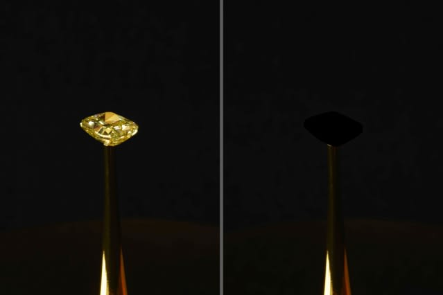A 16.78-carat natural yellow diamond, estimated to be worth $2 million. The team coated it with the new, ultrablack CNT material. The effect is arresting: The gem, normally brilliantly faceted, appears as a flat, black void. (Image courtesy MIT/Diemut Strebe.)
