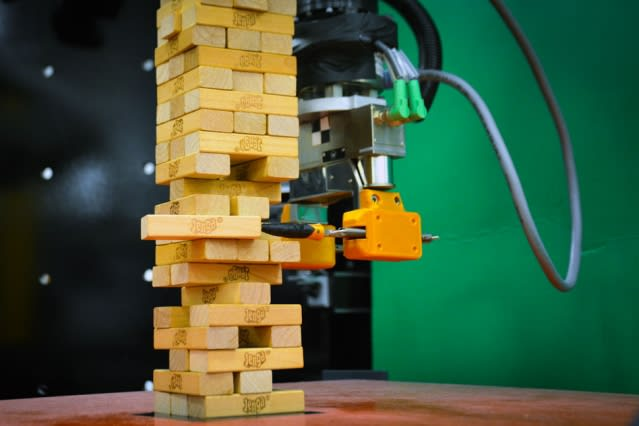 The Jenga-playing robot demonstrates something that's been tricky to attain in previous systems: the ability to quickly learn the best way to carry out a task, not just from visual cues, as it is commonly studied today, but also from tactile, physical interactions. (Image courtesy of MIT.)