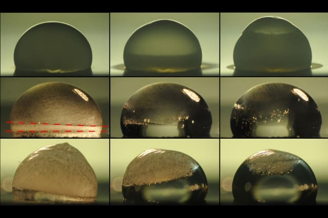 Images of a droplet on a surface show the process of freezing (top row), during which condensation temporarily forms on the outside of the droplet as it freezes. The next two rows show the droplet thawing out on a surface coated with the new layered material. In the middle row, the droplet is heated by the coating immediately upon freezing, and the dashed lines show where the freezing at top is just catching up with the thawing from below. The bottom row shows a slower thawing process. Under identical conditions, the droplet stays frozen without the new coating.  Credit: The Varanasi Research Group