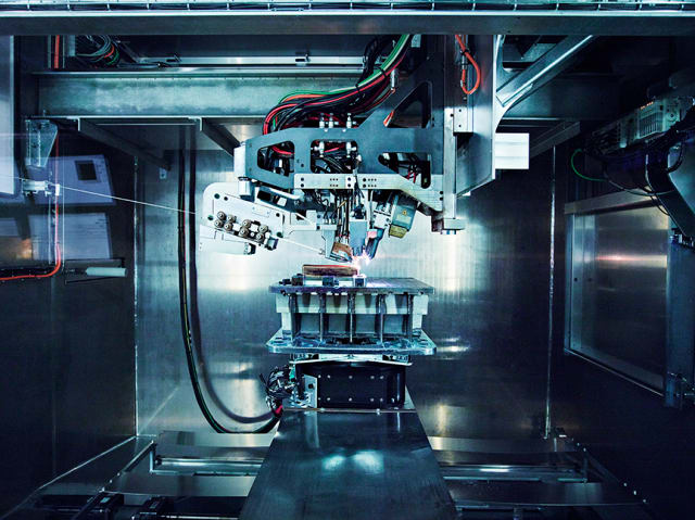 Norsk Titanium's MERKE IV Rapid Plasma Deposition machine producing the world's first FAA-approved, 3D-printed titanium structural components for the Boeing 787 Dreamliner. (Image courtesy of Norsk Titanium.)