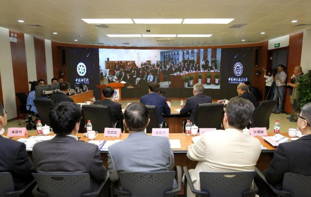 A photography of a quantum-secure intercontinental video conference held between Chinese Academy of Sciences and Austrian Academy of Sciences on 29 September, providing a real-world demonstration of quantum communication. (Image courtesy of Chinese Academy of Sciences.)