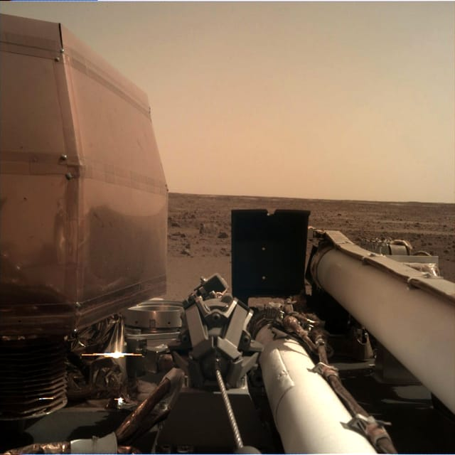 NASA's InSight Mars lander acquired this image on Day 1 (Sol 0) of the mission, using its robotic arm-mounted, Instrument Deployment Camera (IDC). (Image courtesy of NASA.)