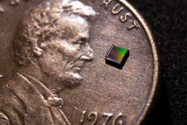 The temperature sensor is integrated into a small chip measuring 0.15 × 0.15 square millimeters in area. (Image courtesy of David Baillot/UC San Diego Jacobs School of Engineering.)