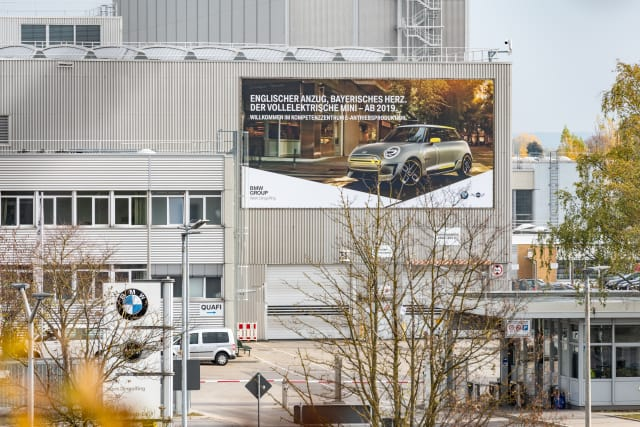 """Billboard on the front of Plant 02.20, the BMW Group's """"Competence Centre for e-drive production."""" (Image courtesy of BMW Group.)"""