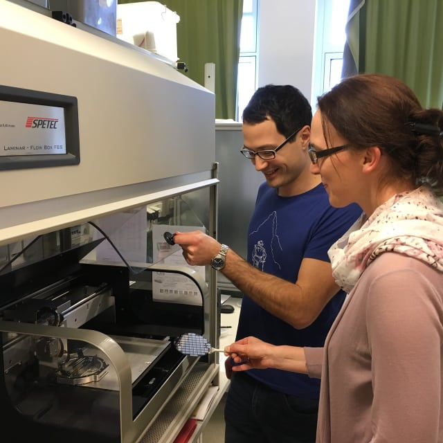 Christina Schindler and Bernhard Huber in front of their inkjet printer in the laboratory. (Image courtesy of Huber et al.)