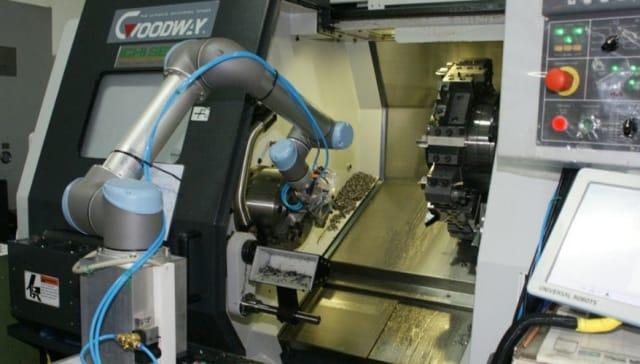 Robot unloading a horizontal lathe. (Image courtesy of Zacobria.)
