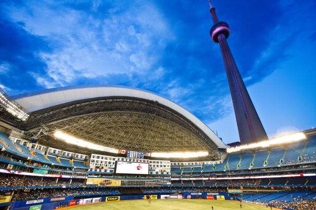 Looking up at the CN Tower from inside the Rogers Centre.