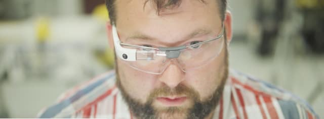 This guy doesn't mind wearing Glass. Picture from Wired magazine, courtesy of AGCO.