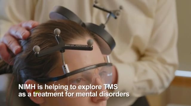 A patient undergoes rTMS treatment. (Credit: National Institute of Mental Health.)