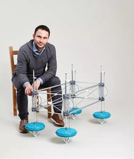 Philipp Sinn, SINN Power founder and CEO, with a miniature model of his company's platform. (Image credit of SINN Power.)