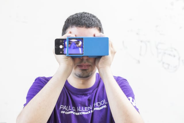BiliScreen is a new smartphone app that can screen for pancreatic cancer by having users snap a selfie. It's shown here with a 3-D printed box that helps control lighting conditions to detect signs of jaundice in a person's eye. (Image courtesy of Dennis Wise/University of Washington.)