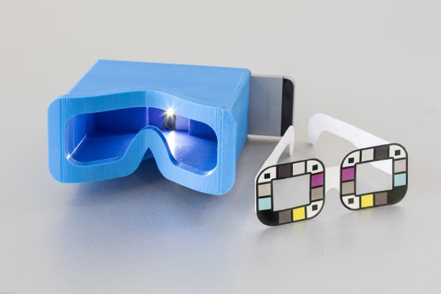 The UW team tested two different accessories for BiliScreen: a 3-D printed box to control lighting conditions and glasses that help the app calibrate colors. The goal is to remove the need for additional accessories, potentially by mining data from facial pictures. (Image courtesy of Dennis Wise/University of Washington.)